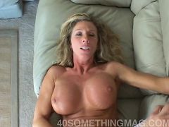 Mature babe rides young stallion on couch
