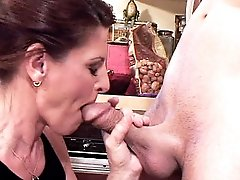 Grandma Linda Roberts spreads her pussy lips wide for a tongue lashing in the kitchen