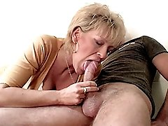 Blonde granny having her pussy fucked on the table