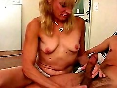 Mature blonde bitch with erect pink nips sucking wildly on huge cock