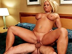 Stacked blonde milf Roxy sucking off her horny bell boy and takes his cock into her pussy by riding on top