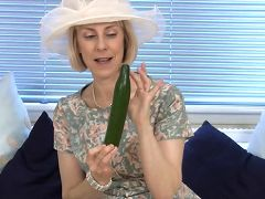 Elegant granny fucks her mature pussy with a thick cucumber