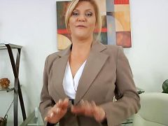 Busty blonde secretary uses a magic wand to masturbate on break