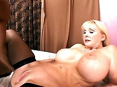 Mature blonde with massive tits licking the cum off a huge cock