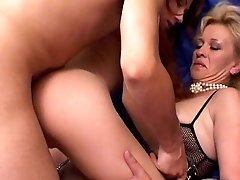 Horny granny enjoying a cunt stuffing threesome