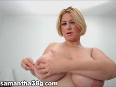 Samantha licks and plays with her tits as she tries to pleasure herself in her own room